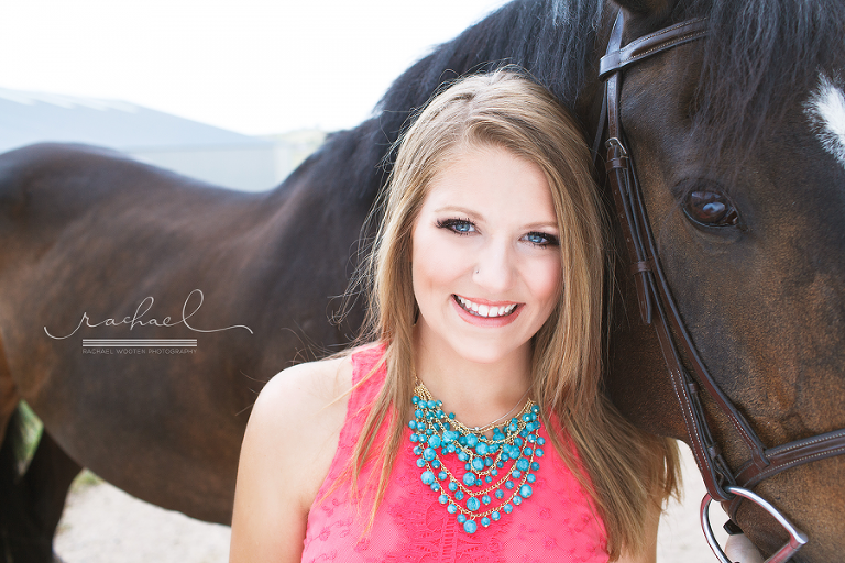 Natural light high school senior girl photos in Denver with professional makeup in a rural setting with a horse.